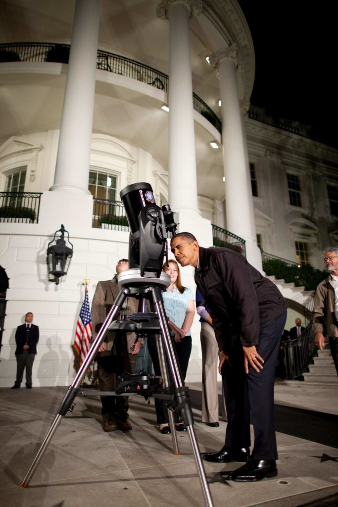 President Barack Obama looks through a telescope during the Astronomy Night event on the South Lawn of the White House, Oct. 7, 2009. (Official White House Photo by Chuck Kennedy) This official White House photograph is being made available only for publication by news organizations and/or for personal use printing by the subject(s) of the photograph. The photograph may not be manipulated in any way and may not be used in commercial or political materials, advertisements, emails, products, promotions that in any way suggests approval or endorsement of the President, the First Family, or the White House.